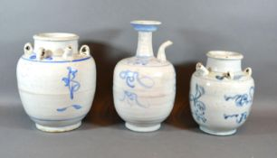 A 19th Century Chinese Wine Vessel decorated in underglaze blue 25cm tall together with another