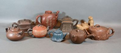 A Chinese Terracotta Teapot together with various other similar matt glaze teapots