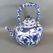 A Chinese Porcelain Teapot Decorated in Underglaze Blue with serpents amongst foliage, six character