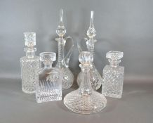 A Pair Of Cut Glass Decanters together with a cut glass ships decanter and three other glass