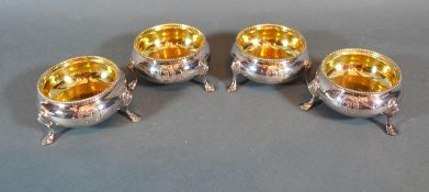 A Set of Four Victorian Silver Salts of Circular Form with Silver gilt interiors each engraved