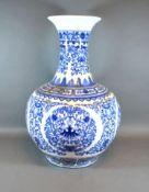 A Chinese Underglaze Blue Decorated Bottleneck Vase, blue seal mark to base, 55 cms tall