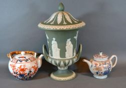 A Wedgwood Jasper Ware Large Covered Vase decorated with classical figures and foliage upon a