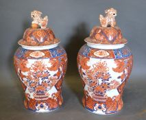 A Pair of Chinese Covered Vases decorated in iron red 49cm tall