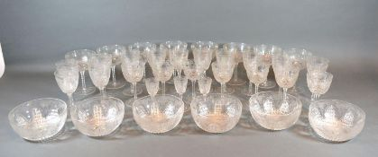 A Cut Glass Drinking Set comprising eight champagne glasses, various other glasses and six finger