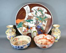 A Large Japanese Charger decorated with a Dragon and Figures within a Landscape, 45 cms diameter,