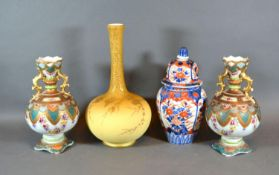 A Pair of Victorian Porcelain Two Handled Vases together with a covered Imari vase and a Victorian
