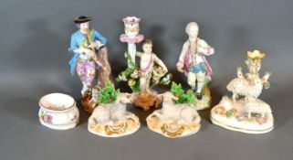 A 19th Century Porcelain Candlestick of figural form, gold anchor mark, 18 cms tall, together with