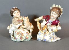 A Pair of Berlin Porcelain Figures in the form of Girls with Cats and Dogs, 14 cms tall