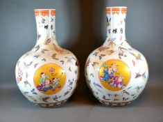 A Pair of Chinese Bottleneck Large Vases each hand painted with reserves depicting figures amongst