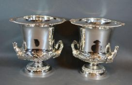 A Pair of Silver Plated Wine Coolers with side handles and circular pedestal bases and with inner