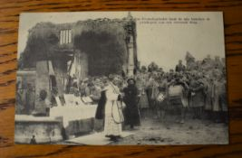 French WWI RP Postcard of a French Priest giving Communion to the Soldiers in the ruins of a Church.