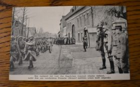 French WWI RP Postcard of a French Regiment marching through a town heading to the front, General