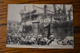 French WWI RP Postcard depicting French Soldiers and Supplies including Horses being loaded onto a