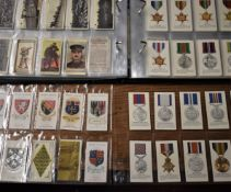 Military Cigarette cards in plastics as an album. Sets, partial sets, some rare cards and some