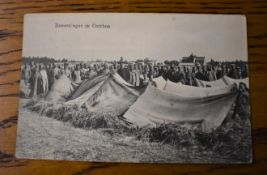 German WWI RP Postcard of Russian Prisoners of War in a P.O.W. Camp in Cottbus, guarded by