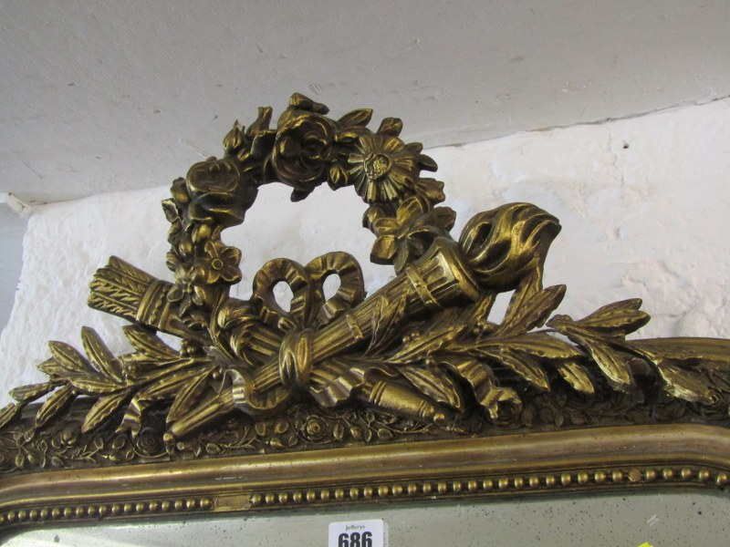 """Lot 686 - GILT HALL MIRROR, floral wreath and emblem crested hall mirror, 39"""" height 24"""" width"""