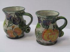 "STUDIO POTTERY, 2 Paul Jackson grape and fruit decorated 4"" jugs"