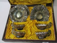 ORIENTAL CERAMICS, cased set of 4 Japanese tea bowls in silver mounts and ornate floral embossed