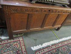 "JACOBEAN DESIGN OAK COFFER, 4 panelled front oak coffer with carved lunette frieze, 60"" width"