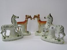 """STAFFORDSHIRE POTTERY, pair of 19th Century Zebras, 8.5"""" height (restored), together with pair of"""