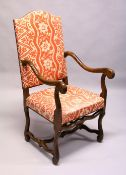 A 20TH CENTURY CONTINENTAL BEECH FRAMED OPEN ARMCHAIR, with floral printed upholstered back and