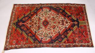 A GOOD SMALL PERSIAN RUG, MID 20TH CENTURY, beige ground with stylised Boteh, birds and flowers. 6ft