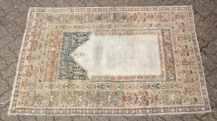 A GOOD EARLY 20TH CENTURY OTTOMAN PRAYER RUG, retailed by Omar of Harrogate. 5ft 8ins x 3ft 11ins.