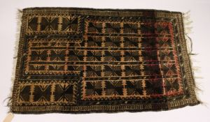 A PERSIAN AFGHAN RUG, EARLY 20TH CENTURY, beige ground with allover stylised designs. 4ft 5ins x 2ft