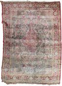 A 19TH/20TH CENTURY PERSIAN TEHRAN SILK CARPET, red ground with numerous vases of flowers, panels of