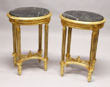 A PAIR OF FRENCH STYLE GILTWOOD ND MARBLE TOP OVAL LAMP TABLES. 2ft 5ins high x 1ft 8ins wide x