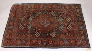 A KASHAN RUG, 20th Century dark blue ground with allover stylized tree and flower decoration. 6ft
