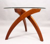 TABLEMAKERS of WIMBLEDON, LONDON, A BALLERINA TABLE, with three curving cherry wood legs, united