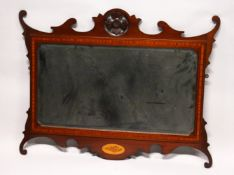 A GEORGE III DESIGN MAHOGANY FRETWORK FRAMED WALL MIRROR, with flower head carved cresting, shell
