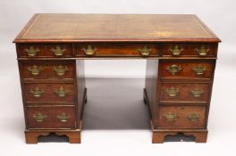 A GEORGE III MAHOGANY PEDESTAL DESK, with gilt tooled leather inset writing surface, three frieze