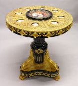 AN IMPRESSIVE EBONISED AND ORMOLU MOUNTED CIRCULAR PEDESTAL TABLE, inset with Sevres style oval