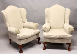 A GOOD PAIR OF GEORGE III DESIGN WING ARMCHAIRS, plain beige upholstery, on carved cabriole legs