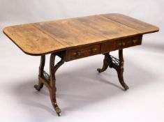 A REGENCY ROSEWOOD SOFA TABLE, with rounded rectangular top, two real and two dummy frieze