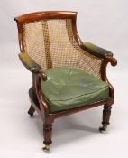 A GOOD REGENCY MAHOGANY BERGERE LIBRARY ARMCHAIR, of typical form, with green leather upholstered