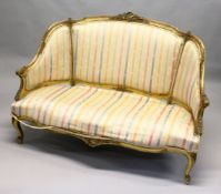 A 19TH CENTURY FRENCH GILTWOOD CANAPE, with later striped satin upholstery. 4ft 6ins wide.