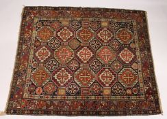 A GOOD, SMALL PERSIAN CAUCASIAN RUG, EARLY 20TH CENTURY, blue ground with allover stylised