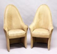 AN UNUSUAL PAIR OF LEATHER UPHOLSTERED HIGH BACK ARMCHAIRS, mid 20th Century. 3ft 11ins high x 2ft