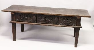 AN 18TH CENTURY SPANISH OAK SERVING TABLE with a single plank top, three carved frieze drawers on