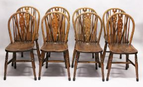 A SET OF EIGHT EARLY 20TH CENTURY BEECH AND ELM WHEELBACK DINING CHAIRS. 3ft 0ins hi9gh x 1ft 3ins