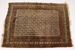 A PERSIAN RUG, early 20th Century, beige ground with a Boteh design, within a four row border. 5ft