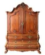 AN 18TH CENTURY DUTCH MAHOGANY BOMBE CUPBOARD, with shell carved arched cornice, pair of panelled