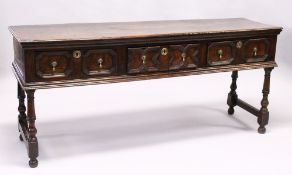 A GOOD 18TH CENTURY OAK DRESSER, with a twin plank top, three drawers each with a pair of
