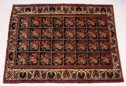 AN UNUSUAL PERSIAN RUG, early 20th Century, possibly Caucasian, the dark blue ground with four