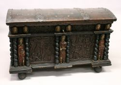 A LARGE AND IMPRESSIVE CONTINENTAL STAINED PINE DOME TOP COFFER, initialled and dated 1700, the