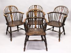 A SET OF FOUR 19TH CENTURY ASH AND ELM LOW BACK WINDSOR ARMCHAIRS. 2ft 11ins high x 1ft 9ins wide.